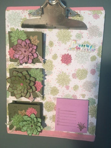 Clipboard designed for a to-do list, including 3D Succulent garden cascading down the side pockets, a magnetic board, and post-it notes.